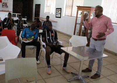 General Secretary Thulaganyo Gaoshubelwe educating the players about their rights as football players.